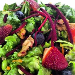 blueberry, strawberry, beet, pecan and multi-green salad