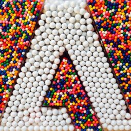 the @adobe logo made of gumballs