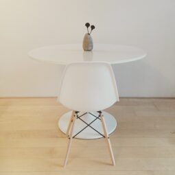 white space: eames + saarinen + vase with african knobs