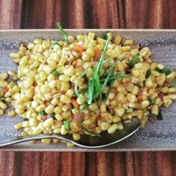 roasted sweet yellow corn tossed in shallots, garlic & spices. amaze