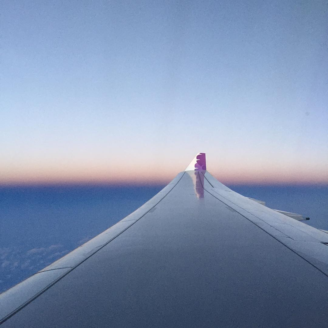 out the window of seat 21j as dusk falls