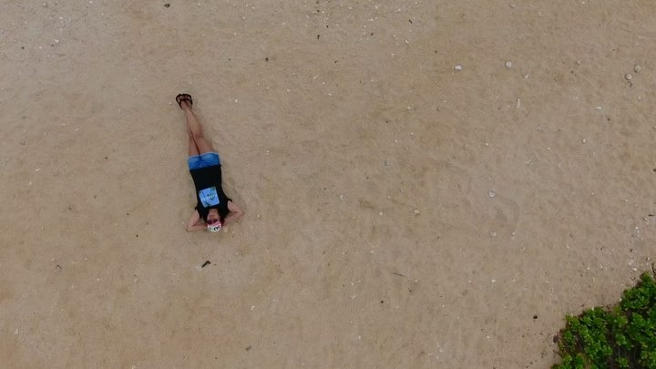 laying in the sand at sandy beach drone videography by @maxkiesler