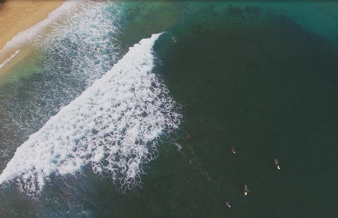 outside-in view of makaha surfers and shorebreak