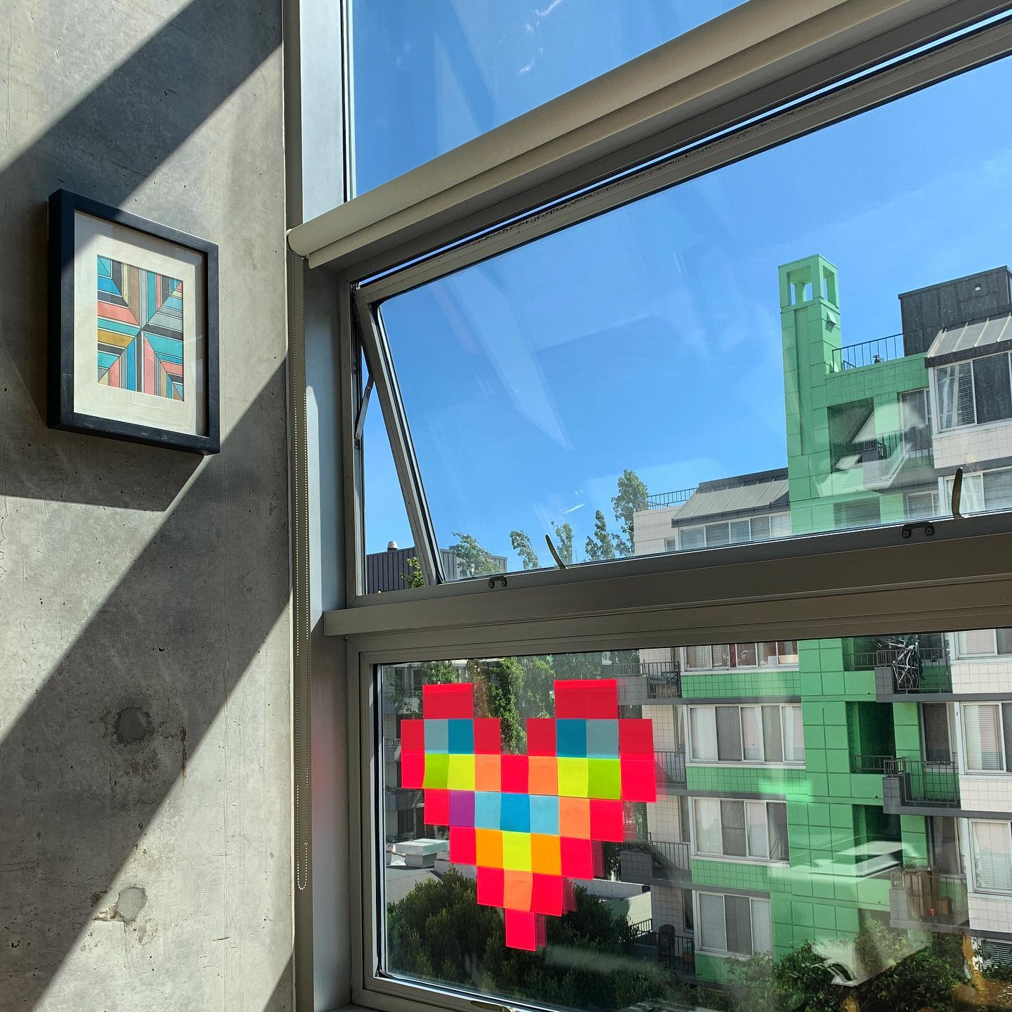 Love will set you free. Post-it note art for the neighbors across the street.