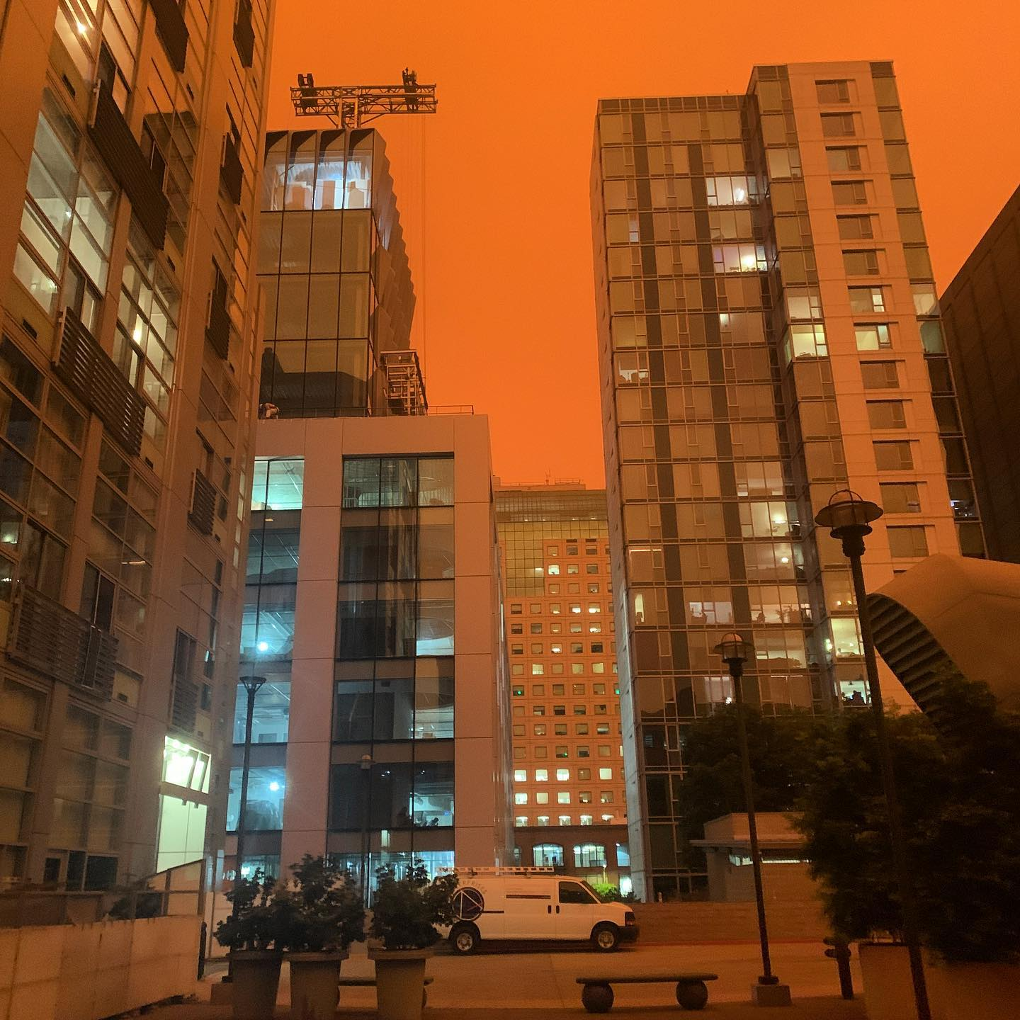 This is outside our building this morning as wildfire smoke in the atmosphere hovered over SF today blocking sunlight and turning the sky a dark, orange haze. It was like night during the day. Hoping the wind shifts and the smoke or ash doesn't start to drift down. Air last week was pretty bad already. At least there's no power outage at the same time.
