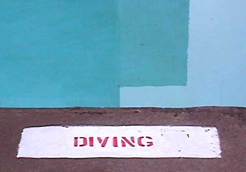 photo of diving sign next to pool